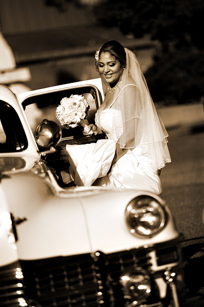 bride in vintage car - photographed by this is it photography
